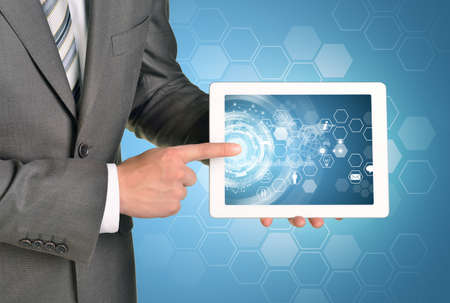 Man hands using tablet pc. Image of business elements on tablet screen photo