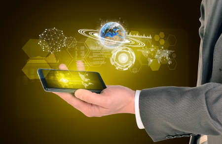 using smart phone: Man hands using smart phone. Image of world map on phone screen. Stock Photo