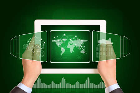 using tablet: Man hands using tablet pc. Image of world map and network on tablet screen