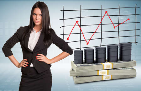 Angry businesswoman with packs dollars and barrels oil. Schedule of price increases in background photo