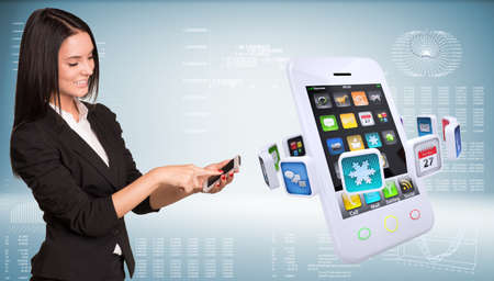 holding smart phone: Businesswoman holding smart phone and smiling. Big smart phone with app icons. High-tech graphs at backdrop
