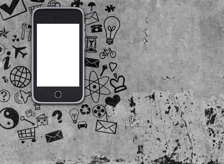 Smart phone on concrete floor with various social icons. Phone concept photo