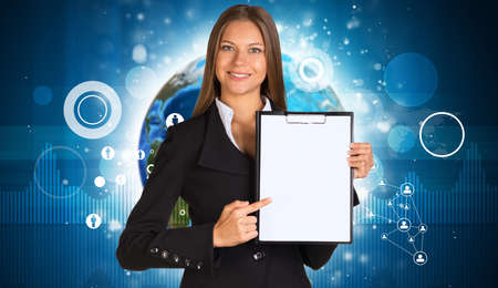 Beautiful businesswoman in suit holding paper holder. Earth and graphs in background. Elements of this image furnished by NASA photo