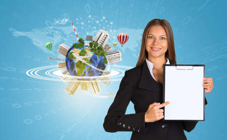 Beautiful businesswoman in suit holding paper holder. Earth with buildings and figures in background. Elements of this image furnished by NASA photo