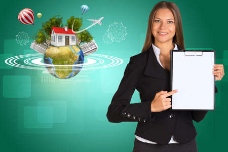 Beautiful businesswoman in suit holding paper holder.  photo