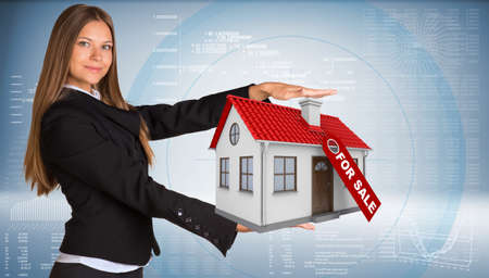 half turn: Businesswoman smiling and holding house in hand. Business concept