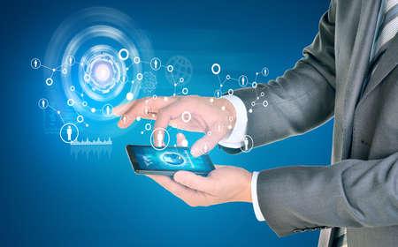 Man hands using smart phone. Earth on phone screen. Network near phone. photo