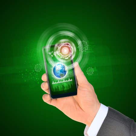 Man hand using smart phone. Earth on phone screen. photo