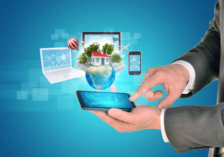 smart man: Man hands using smart phone. Electronics near Earth. Laptop, internet tablet and phone. Element of this image furnished by NASA Stock Photo