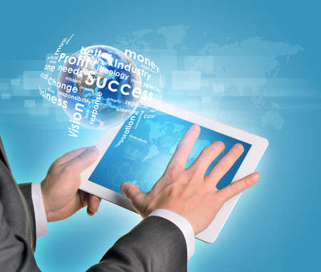 Man hands using tablet pc. Earth and business words near computer.   photo