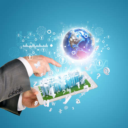 Man hands using tablet pc. Business city on touch screen. Earth near tablet. Element of this image furnished by NASA photo