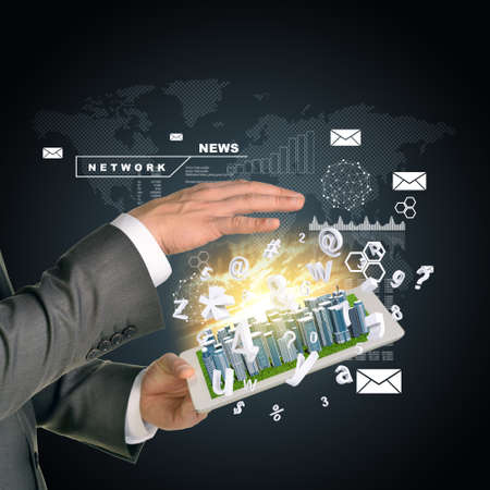 Man hands using tablet pc. Business city on touch screen. Business concept photo