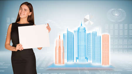 Businesswoman hold paper sheet. Wire-frame glowing buildings on transparent plane. Graphs as backdrop photo