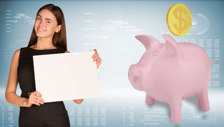 Businesswoman hold paper sheet. Pink piggy bank with gold coin are located next. Hi-tech graphs as backdrop photo