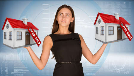 Businesswoman holding two house with tags for sale and rent. Hi-tech graphs as backdrop. Business concept photo