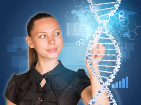 Beautiful woman in dress pointing finger on DNA model. Virtual elements as backdrop photo