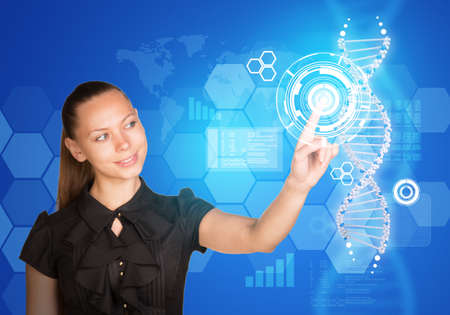 Beautiful businesswoman in dress smiling and presses finger on model of DNA. Scientific and medical concept photo
