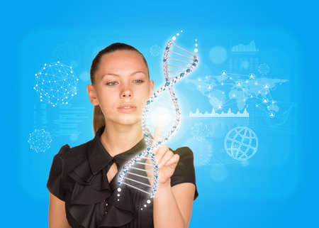 Young girl in dress pushing finger on model of DNA. World map and other virtual elements as backdrop photo