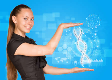 dna smile: Beautiful businesswoman in dress smiling and holding model of DNA. Scientific and medical concept