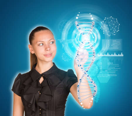 Beautiful young girl with big eyes smiling and presses finger on model of DNA. Scientific and medical concept photo