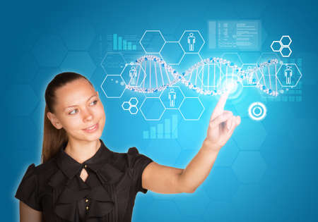Beautiful young girl smiling head bent and presses finger on model of DNA. Scientific and medical concept photo