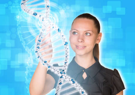Beautiful young girl looks at model of DNA and presses her finger. Scientific and medical concept photo