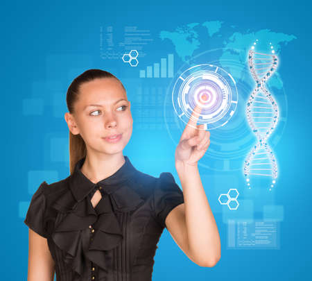 high scale: Beautiful businesswoman in dress smiling and presses finger on model of DNA. Scientific and medical concept