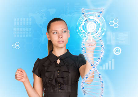 Young girl looks at model of DNA and presses her finger. Scientific and medical concept photo