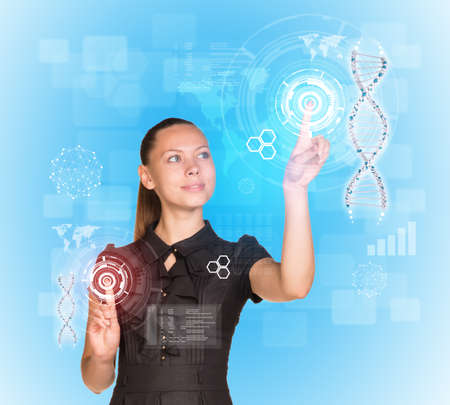 Beautiful businesswoman in dress smiling and presses fingers on model of DNA. Scientific and medical concept photo