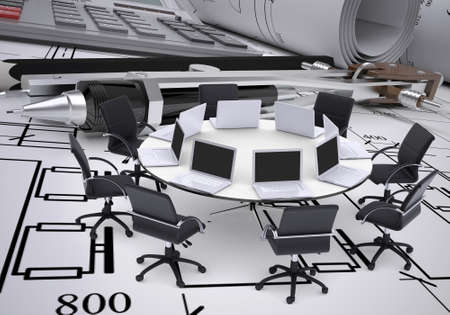 roundtable: Miniature round table with laptops on it and chairs around, drawing compasses, placed on spread technical drawing. Construction business concept Stock Photo