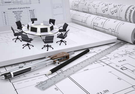 roundtable: Miniature round table with laptops on it and chairs around, drawing compasses, placed on spread architectural drawing. Construction business concept Stock Photo