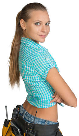 Pretty girl in shorts, shirt and tool belt with tools standing with crossed arms. Rear view. Isolated over white background photo