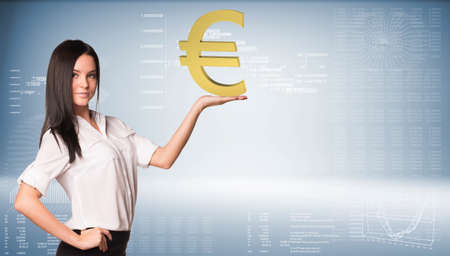 euro sign: Beautiful businesswoman in white shirt and black skirt holding euro sign. Graphs and texts as backdrop Stock Photo