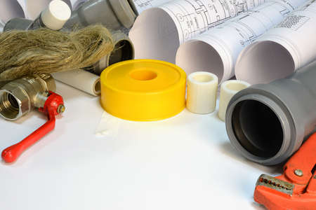 sealing tape: Drawing rolls, gas wrench, pipe joints, Y fitting, ball valve, drain pipe, plumbers tape, sealing paste, sanitary tow Stock Photo