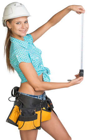 Beautiful girl in white helmet, shorts and shirt holding tape-measure. Isolated over white background photo