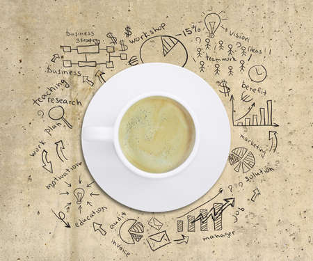 Business strategy infographics option drawn around coffee cup, on smooth stone surface, top view photo