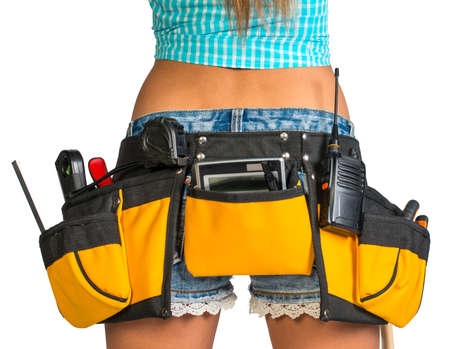 Woman wearing shirt. shorts and tool belt with tools, close up, back view, isolated on white background photo