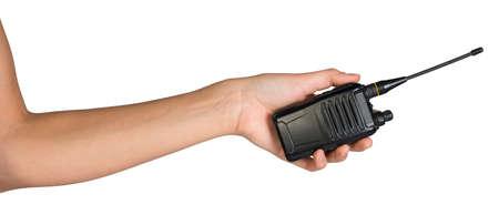 Female hand, bare, holding portable radio transmitter, isolated over white background photo