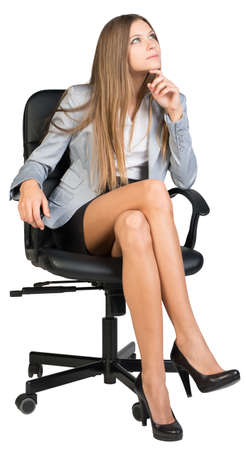 half turn: Businesswoman on office chair with her finger under chin, looking upwards to her left. Isolated over white background Stock Photo