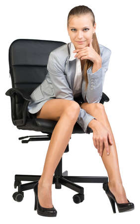 half turn: Businesswoman on office chair, looking at camera, with her head reclined upon her hand. Isolated over white background Stock Photo