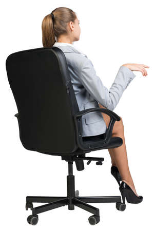 half turn: Businesswoman on office chair, half-turn from behind, making gesture as if talking to someone. Isolated over white background