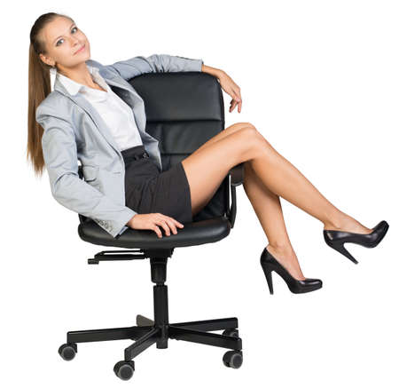 half turn: Businesswoman on office chair with her legs over armrest, leaning back, looking at camera. Isolated over white background