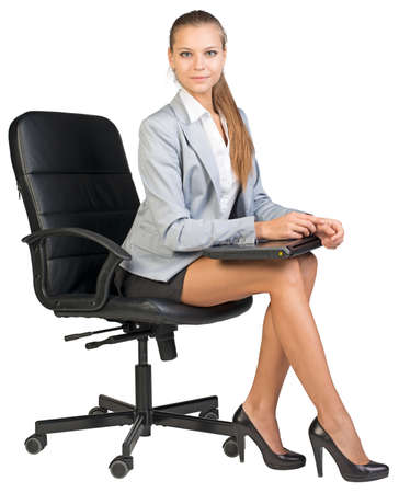 half turn: Businesswoman on office chair, holding closed laptop on her knees, looking at camera. Isolated over white background