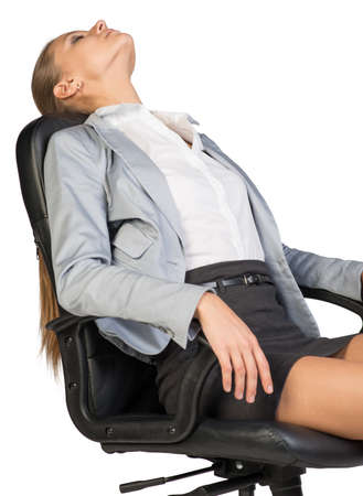 lean back: Businesswoman resting in office chair with her head thrown back, her eyes closed, her arms on armrests. Isolated over white background Stock Photo