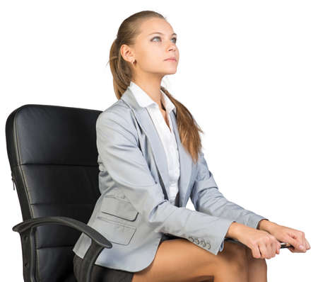half turn: Businesswoman sitting on office chair holding clipboard on her knees, looking ahead. Isolated over white background Stock Photo
