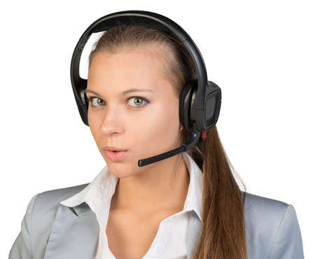 Businesswoman in headset with her head half-turned to her right, her lips pursed, looking at camera. Isolated over white background photo