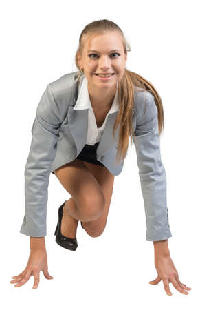 Businesswoman standing in running start pose, smiling, front view, Isolated over white background photo