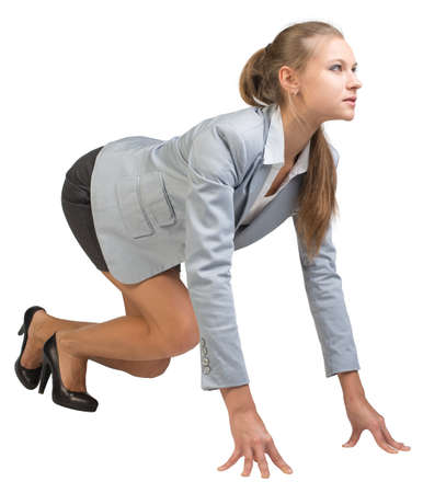 Businesswoman standing in running start pose, half-turn. Isolated over white background photo