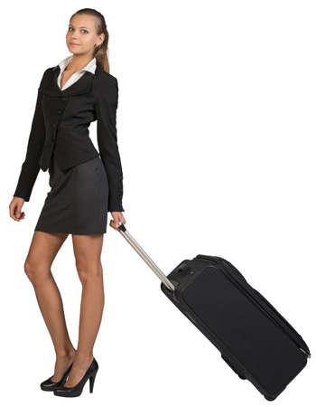 Businesswoman holding wheeled bag in moving position, looking at camera, smiling. Isolated over white background photo