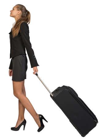 wheeled: Businesswoman walking with wheeled travel bag. Isolated over white background Stock Photo